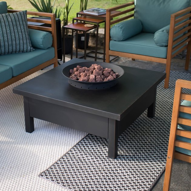 Perfect for centering in a group of patio chairs or L-shaped patio set, the square-shaped Coral Coast Liv 35 in. Fire Table with Free Cover will complete your outdoor area with style and warmth. This fire table comes with lava rock and a convenient fire pit cover.