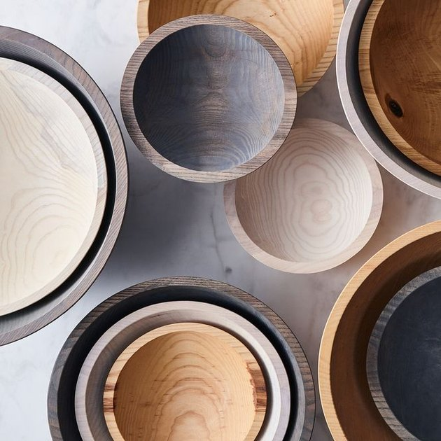 These statement wooden bowls in a variety of versatile sizes are each hand carved from New England ash wood and finished with a food safe teak oil. We love the smaller bowls for party-sized dips and spreads, while the larger ones make pretty work out of farmer's market salads, a dozen eggs, or a big pile of gorgeous, seasonal fruit.