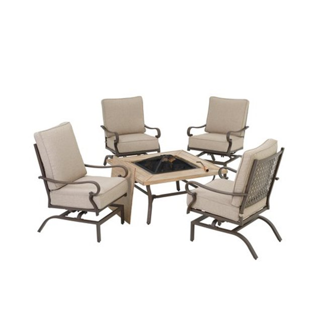 Warm up your outdoor setting with the Mainstays Ellis Garden 5-Piece Outdoor Fire Pit Patio Set. Thisset includes a square fire pit table surrounded with four comfortable lounge chairs with beige cushions. The handsome square table is durably crafted in steel, with a smooth top finished to resemble weathered driftwood.
