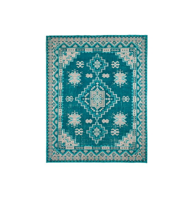 The worldly traditional rug in colors you've never seen before. Featuring geometric medallions and a traditional bordered design, this rug brings a bohemian-chic look to any room. We love the saturated blue hue for a pop of color too.
