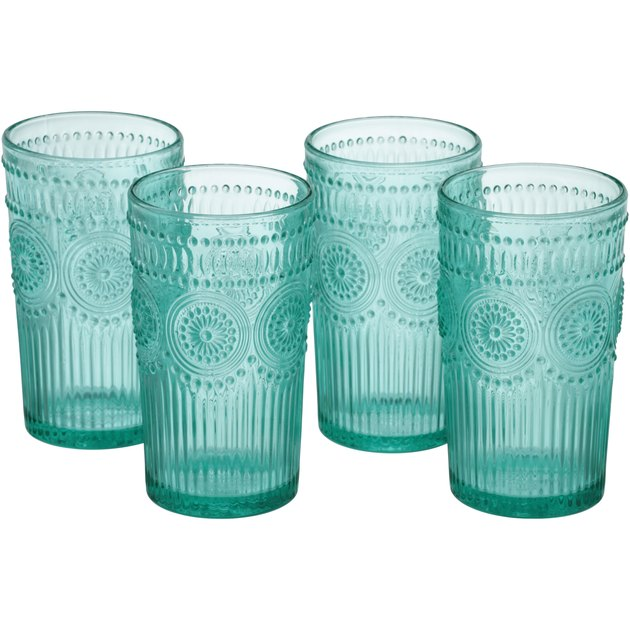 The Pioneer Woman Adeline 16 oz Embossed Glass Tumbler 4-Piece Set, Turquoise is a great way to add a little country charm to your drinkware collection. These beautiful 16 oz glass tumblers are decorated with vintage embossed country designs that bring a charming farmhouse feeling to any occasion.