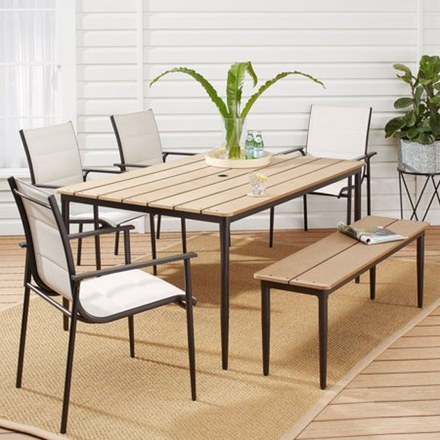 Dine and relax comfortably in the Mainstays Seiland Bay 6-Piece Patio Sling Mesh Dining Set. The sleek Scandinavian designs have a timeless look you'll enjoy gathering together in for years. The set includes a table, four arm chairs, and a dining bench that seats two.