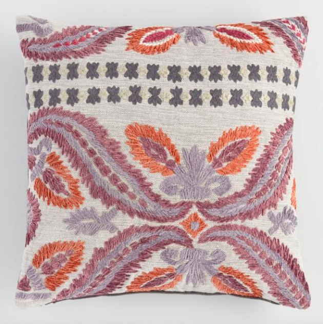 Pairing big, bold florals with geometric lines, our exclusive Jali pillow is crafted in India with chenille embroidery in a rich palette of purple and orange hues. Finished with charcoal-black herringbone fabric on the reverse, it helps create a noteworthy seating scene.