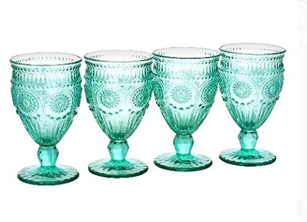 This stunning set features strong statement pieces composed of durable, embossed pressed glass. Four goblets are included with this glass drinkware. Decorative and functional, their embossed texture adds elegance to any beverage, even a simple glass of water. They have a timeless design that will add character to the table.