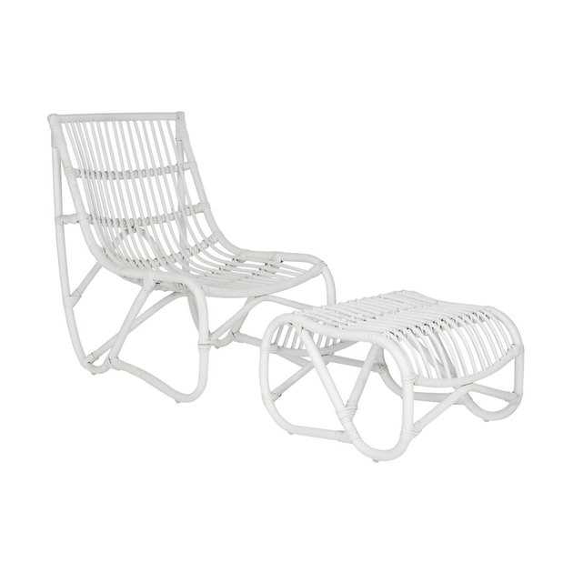 Inspired by mid-century modern rattan chair swings, the Shenandoah chair and ottoman bring a comfortable, minimalist design aesthetic to indoor spaces and covered outdoor porch or patio. Crafted of rattan in chic white finish, the curvy silhouettes of chair and separate ottoman ensure relaxation in style.