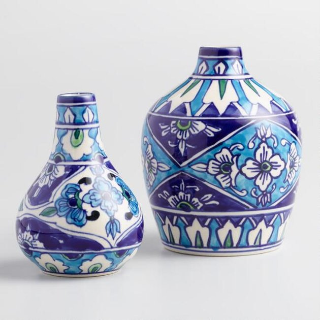 Our shapely Jaipur vases are hand painted with rich, blue-toned floral motifs by Indian artisans using traditional techniques. Displayed individually or together, empty or filled with flowers, each subtly unique piece brims with authentic global style