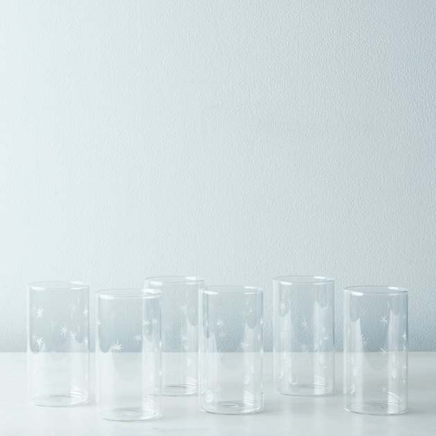 Wish upon a star… for glasses both functional and fanciful. These etched tumblers are a gussied up version of your everyday glassware, adorned with a scattered starburst etching. While lightweight and thin, they're made of durable borosilicate glass so they won't turn cloudy after repeated use, and won't leach any colors or odors. The glasses come in a set of 6, and are available in either a 12-ounce (large) or 10-ounce (medium) size. Bedside table to buffet table, Friday nights to family feasts, picnics to parties, these glasses will shine.