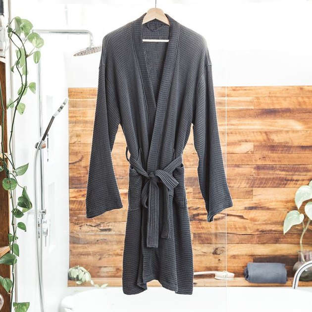 Meet your new favorite bath and shower companion. This unisex bamboo waffle bathrobe is designed with a honeycomb texture to make it ultra-soft, moisture-wicking, and fast-drying. Throw on this robe to get cozy after your bath or shower, or simply to relax around the house. Guaranteed to make doing your daily house chores all the more comfortable.