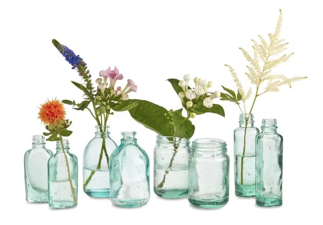 The glass blowers of this newly opened country have created exquisite little vessels to contain the oils and potions of traditional medicine. Design Ideas designers suggest alternative uses for this delightfully shaped containers, vases as beautiful as any the hand of man can devise.