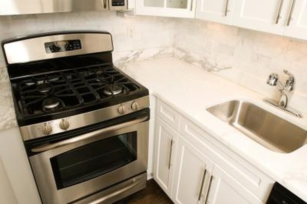 How To Clean An Oven With White Vinegar Amp Baking Soda Hunker