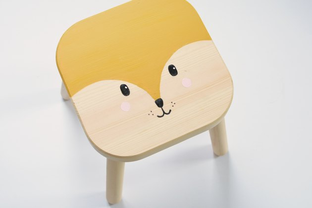 Kid's wood stool with painted cartoon fox face