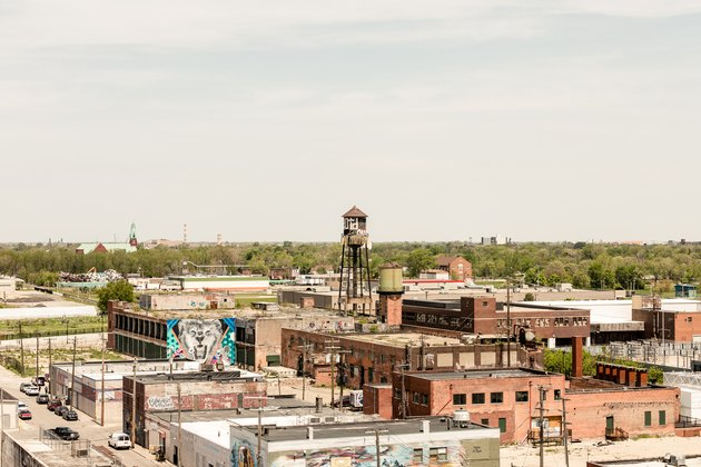 Distance view of city with industrial brick buildings and water tower