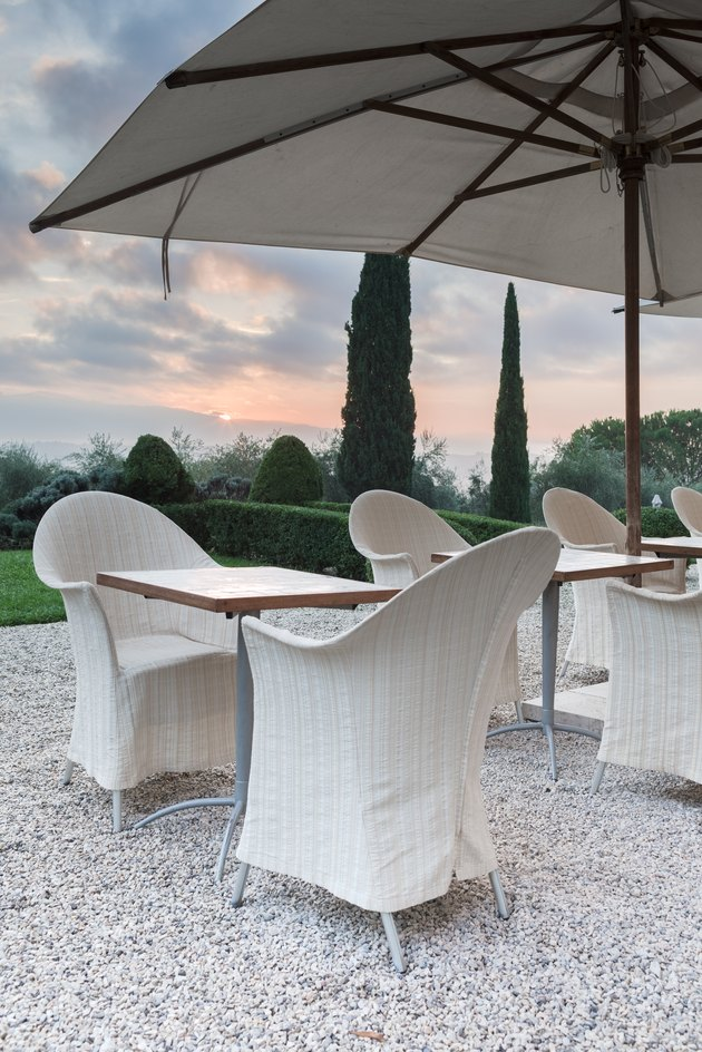 Outdoor white patio dining tables at dusk