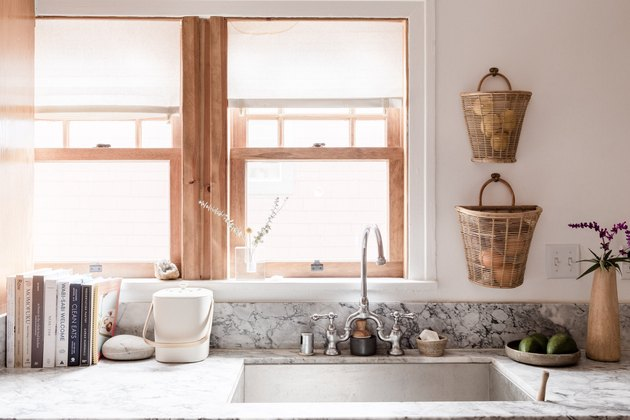 farmhouse sink and a grey countertop in a minimalist kitchen