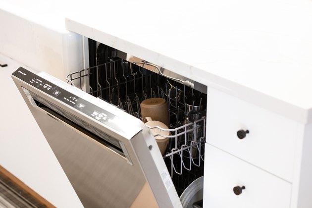 open dishwasher in white kitchen