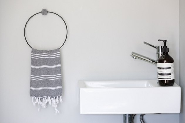 small sink with turkish hand towel and aesop hand soap