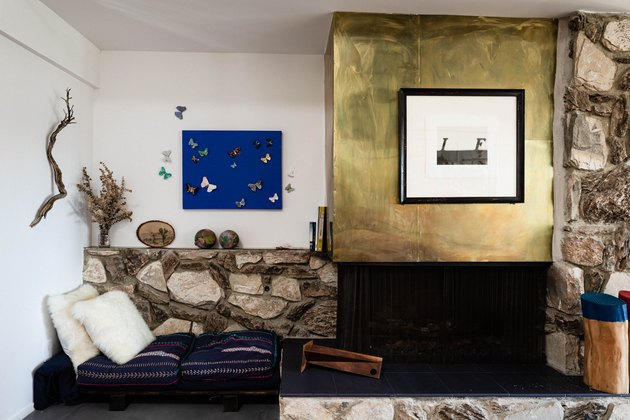 brass fireplace surround with stone mantel