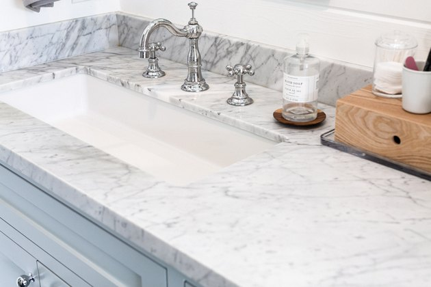 Marble countertop, white undermount sink, silver faucet and handles