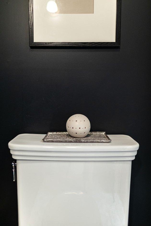 A toilet with a decorative sculpture