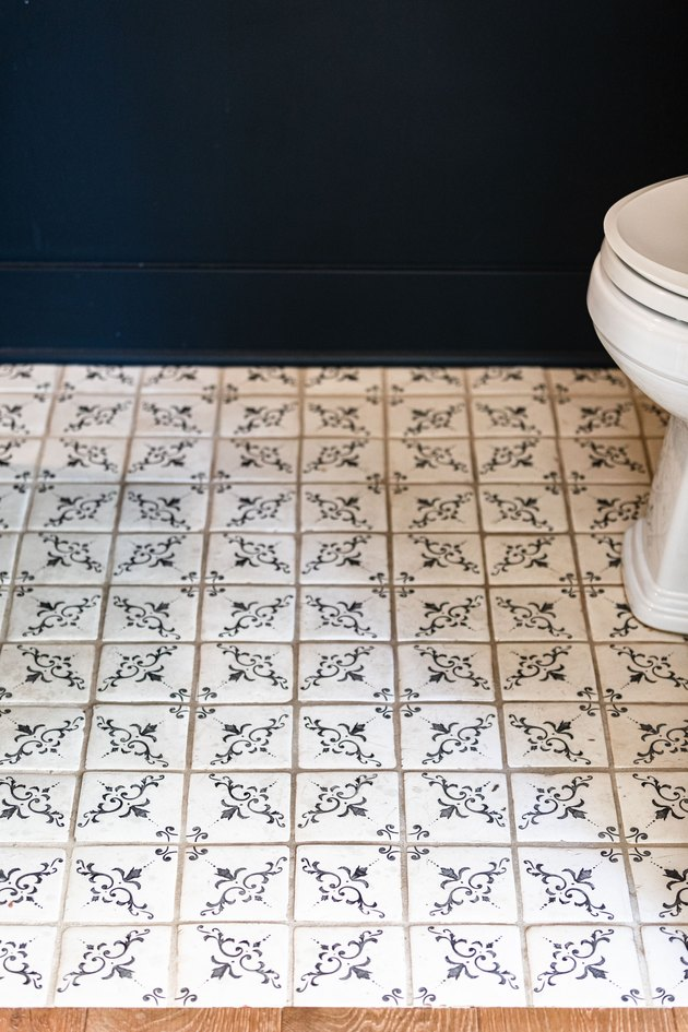 White-blue floral tiles in a bathroom with blue walls