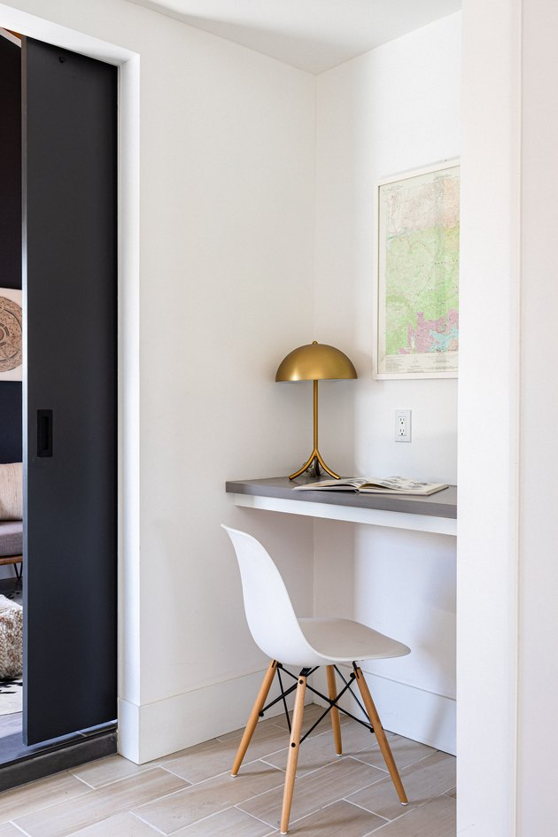 white hallway with desk in the corner