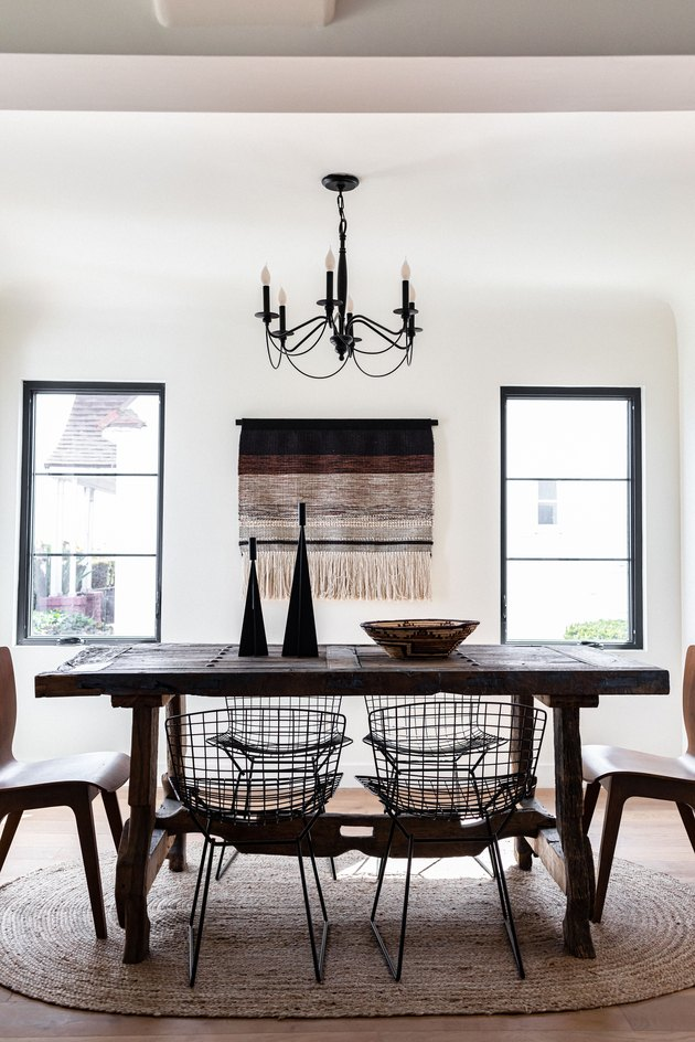 White-walled dining room with wood dining furniture and black-beige accents