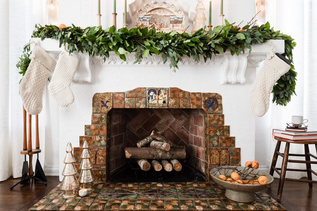 contemporary Christmas decor with vintage fireplace decorated with garland for christmas