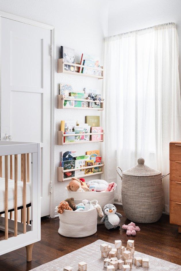book storage in white nursery with wall mounted bookshelf
