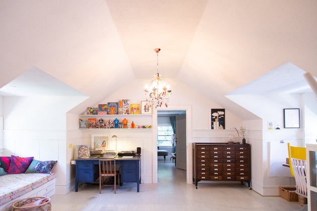 attic idea with office and seating area and chandelier
