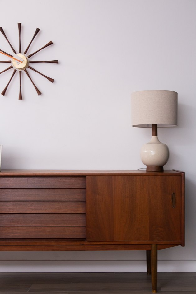 midcentury modern credenza, lamp, and wall clock