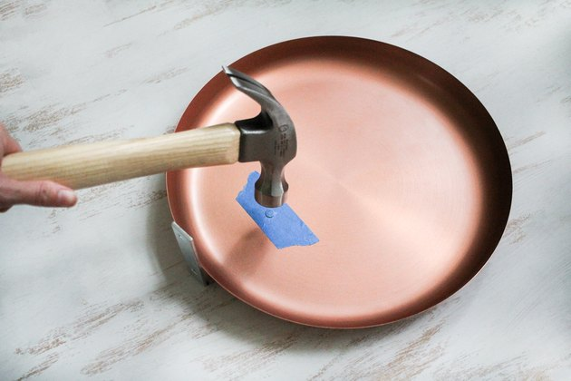 Hammer and round plate with blue painter's tape
