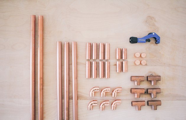 all the copper pieces needed for the clothing rack, including t-joints, elbow fittings, and end caps