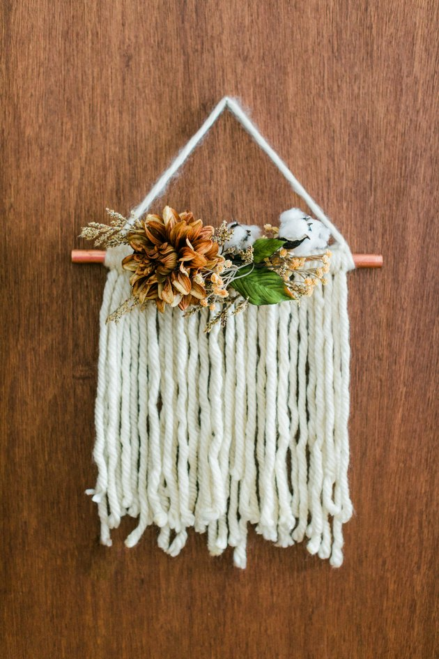 Thanksgiving door hanging with white yarn and faux flowers