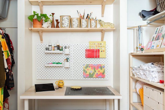 Craft Storage above White work desk with shelves and craft peg board