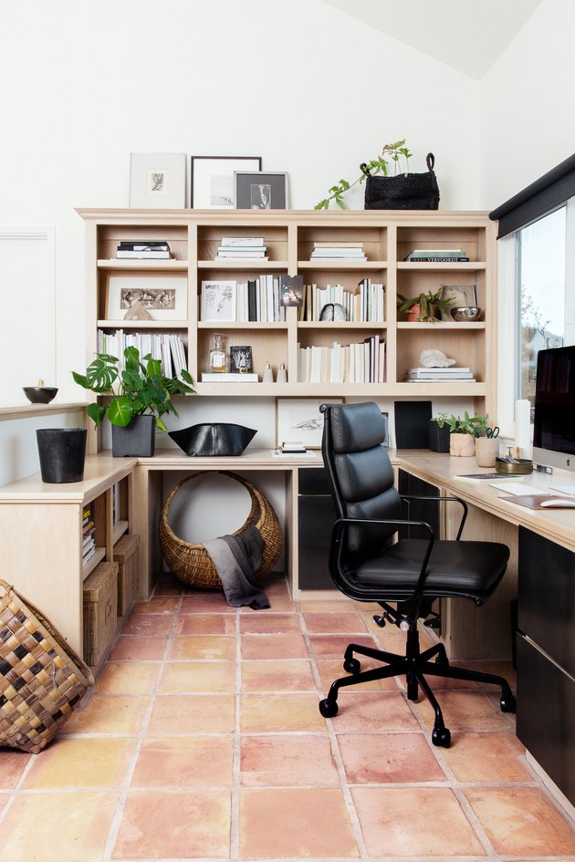 white home office with wooden bookshelves