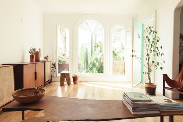 minimalist midcentury room with arched windows