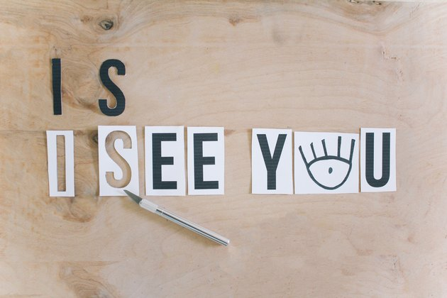 """creating templates for the """"i see you"""" message by cutting printed letters with a utility knife"""