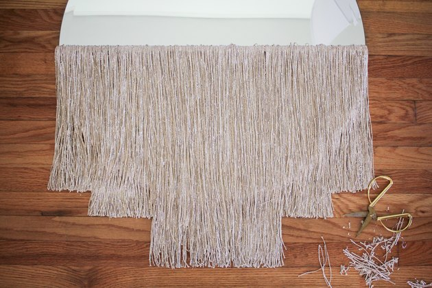 Round curtain fringe mirror with gold scissors