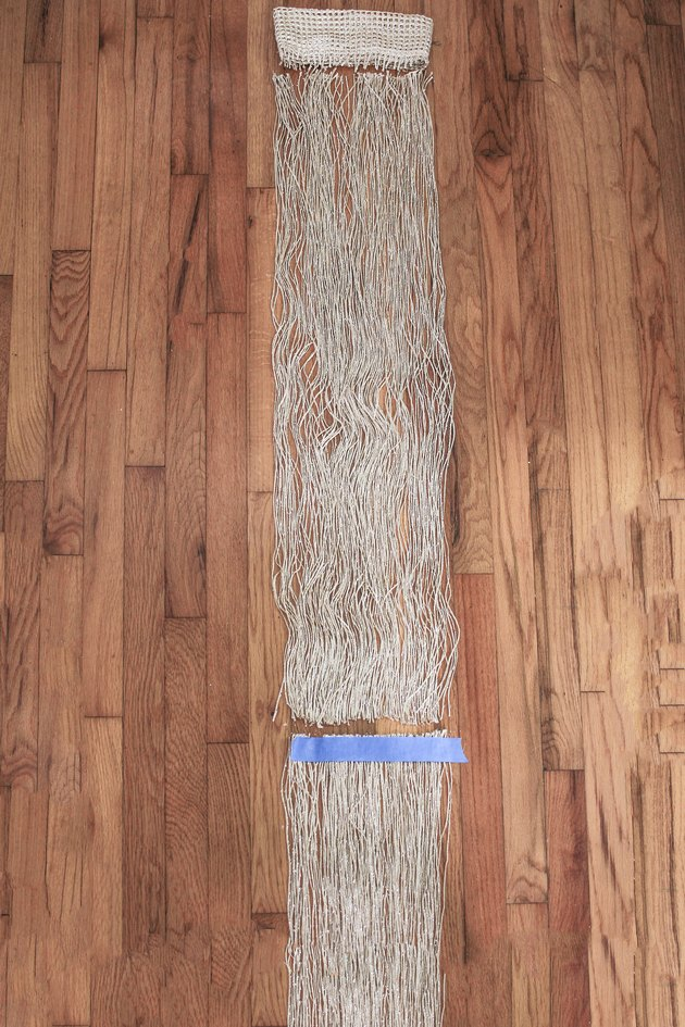 Neutral curtain fringe on wood floor