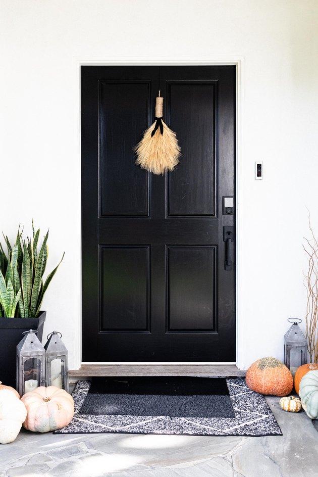 black exterior door with autumn decor
