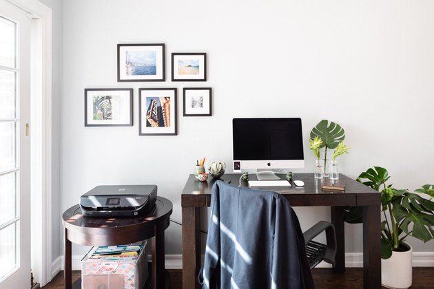 Modern minimalist small home office idea with small gallery wall and wood desk
