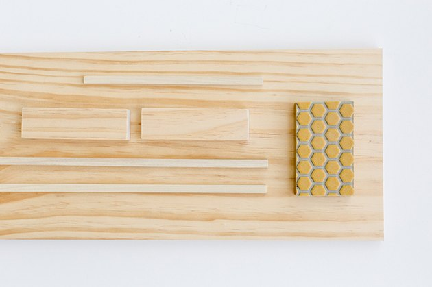 Wood board with sanding block