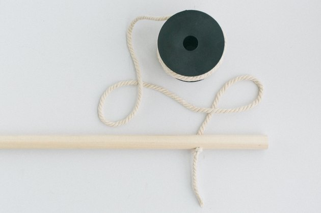Wood dowel with spool of rope