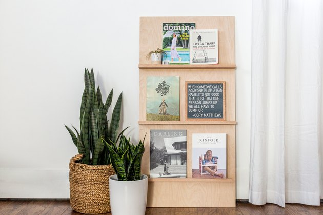 a magazine rack made of plywood and oak shelves