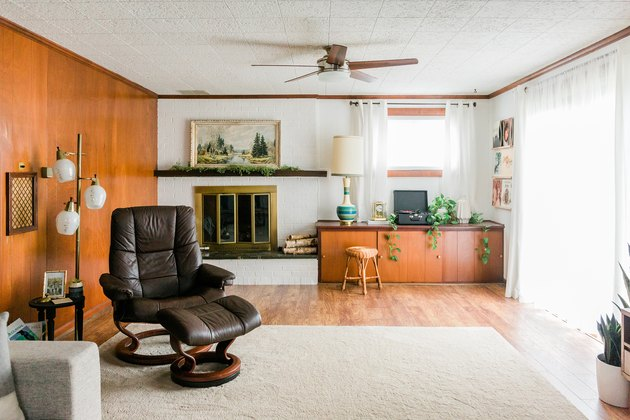 Living room with leather and wood mid-century furniture and wood walls