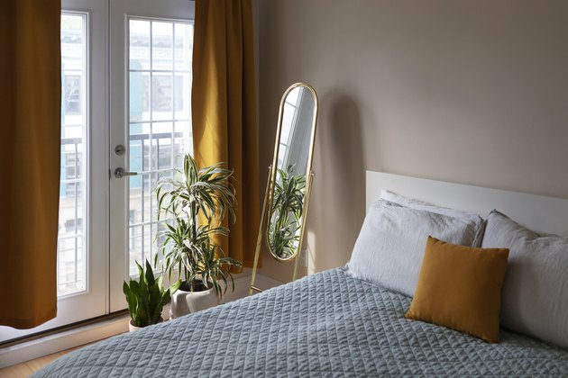 bedroom with glass doors and mirror
