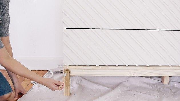 Hands painting wood IKEA dresser