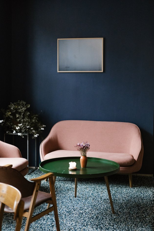 colors that go with blue, retro pink sofa and green coffee table on green shag rug and blue wall