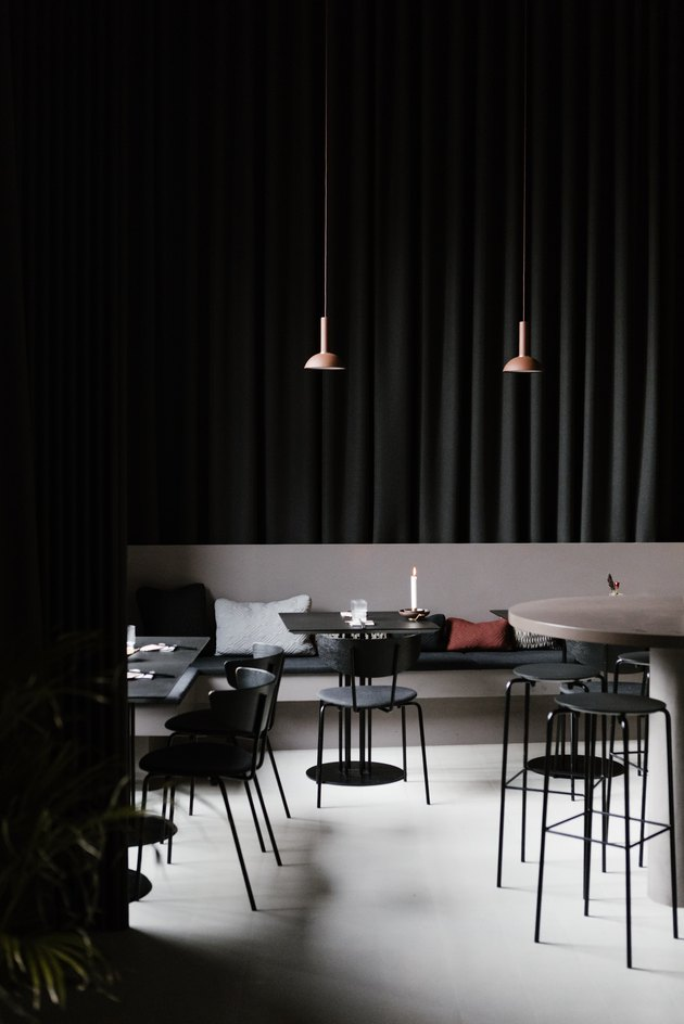 Minimalist bar with black dining furniture and pendant lights