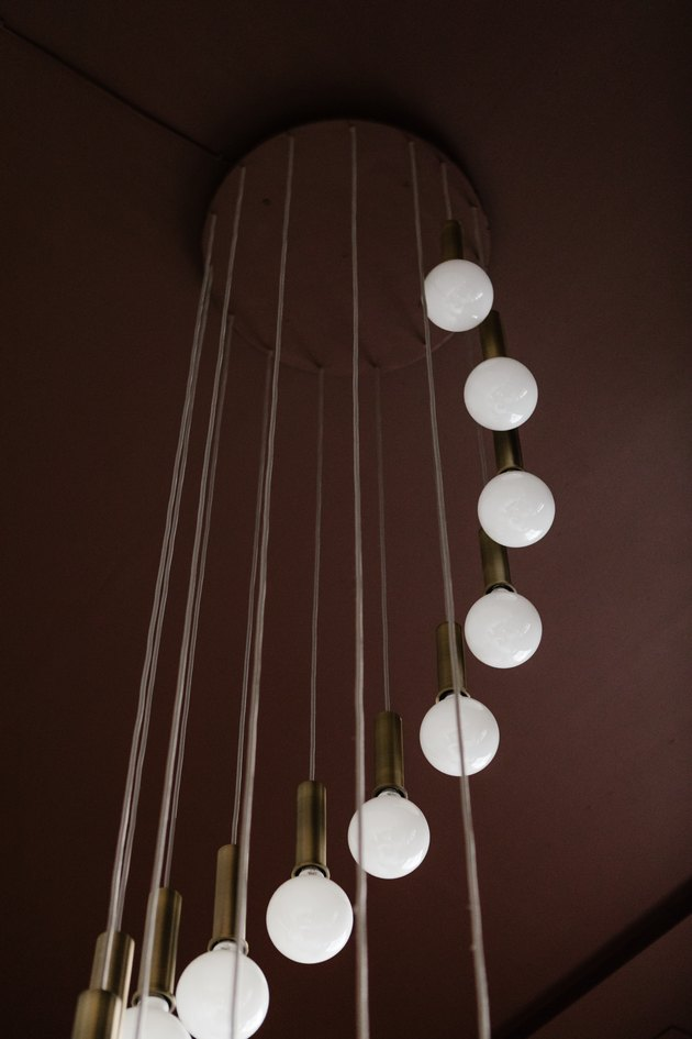 Sphere pendant lights hanging from brown wall